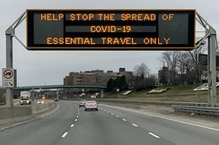 A highway sign on the Gardiner Expressway in Toronto discouraging non-essential travel