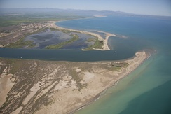 Aerial picture of the Ebro river's mouth as it enters into the Mediterranean Sea by the Ebro's delta.