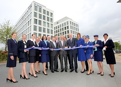 Image of the head office at Gateway Gardens, with Condor employees wearing uniforms from different time periods