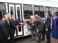 Honda (center) at the August 2006 ribbon-cutting ceremony for the opening of a zero-emissions, hydrogen fuel cell bus program