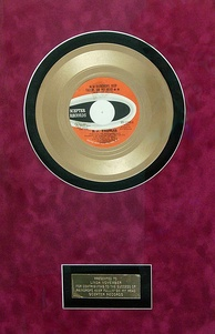 "Gold record presented to backup singer Linda November for her work on ""Raindrops Keep Fallin' on My Head"""
