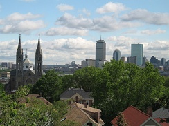 View of Mission Church and Boston skyline from near top of Mission Hill