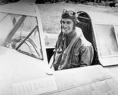 "First Lieutenant Lawrence F. O'Neill of the 342nd Fighter Squadron, in the cockpit of his Republic P-47D Thunderbolt, AAF Serial No. 42-22903, which he christened ""Kathy/Veni Vidi Vici,"" following his quadruple victory on 26 December 1943. O'Neill survived the war and reached Ace status with a total of 5 aerial victories."