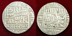 Silver coins with raised writing