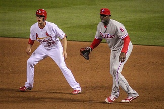Howard holding Cardinals outfielder Stephen Piscotty in 2016