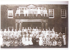 Ellen Isabel Jones sitting front in darker clothing, next to her husband Dr Ernest Williams Jones. The Manor, Aldridge which served as a hospital during WW1.