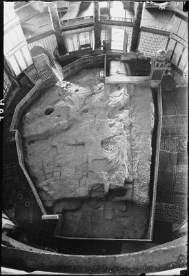 The Foundation Stone in the floor of the Dome of the Rock shrine in Jerusalem. The round hole at upper left penetrates to a small cave, known as the Well of Souls, below. The cage-like structure just beyond the hole covers the stairway entrance to the cave (south is towards the top of the image).