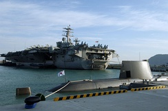 USS Nimitz is moored near ROKS Son Won-il, a Type 214 submarine, at Busan Naval Base, Republic of Korea