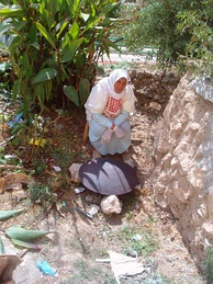 A Palestinian woman baking markook bread on tava or Saj oven in Artas, Bethlehem, Palestine
