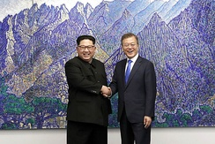 Kim Jong-un and South Korean President Moon Jae-in shake hands during the inter-Korean Summit, April 2018