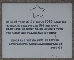 Plaque on a war memorial in Pristina. The text reads At this location on October 23, 1944, German Nazis executed 104 Albanian patriots who gave their lives for the freedom and independence of their country - Society of anti-Nazi and national liberation veterans of Kosovo.