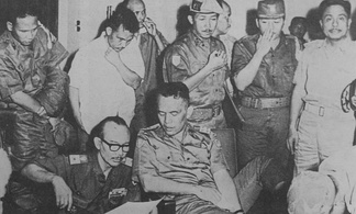 Nasution having his foot treated while discussing the situation at Kostrad HQ on the night of 1 October 1965