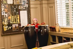 A child playing congas in the Amy Grant Music Room at St. Jude Children's Research Hospital