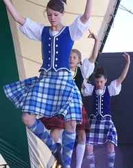 Highland dancing in traditional Gaelic dress with its tartan pattern