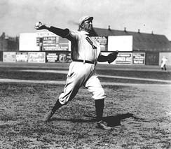 Cy Young—the holder of many major league career marks, including wins and innings pitched, as well as losses—in 1908. MLB's annual awards for the best pitcher in each league are named for Young.