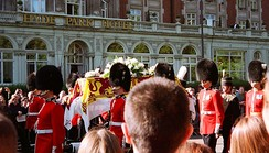 Diana's coffin, draped in the royal standard with an ermine border, borne through the streets of London on its way to Westminster Abbey