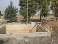 Irrigation water is pumped from this tank which stores effluent received from a constructed wetland in Haran-Al-Awamied, Syria.