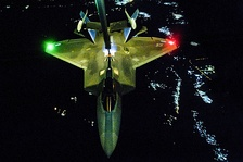 An F-22 Raptor being refueled prior to an airstrike on ISIL targets in Syria