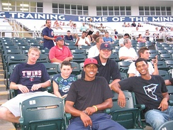 Four players from the 2008 GCL Twins & a fan smile for a picture