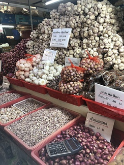 Garlic bulbs and cloves for sale at the Or Tor Kor market in Bangkok
