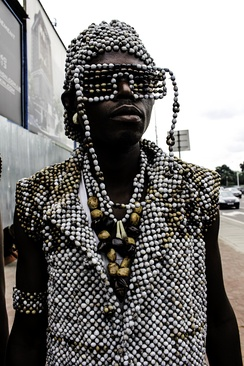 Kinoi sapeur in 2015 wearing a beaded outfit incorporate an homage to shutter shades.