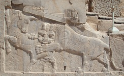 Persian low or bas-relief in Persepolis – a symbol of Zoroastrian Nowruz – at the spring equinox the power of  the bull (personifying Earth) and lion (personifying the Sun) are equal.