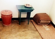 The inside of Mandela's prison cell as it was when he was imprisoned in 1964 and his open cell window facing the prison yard on Robben Island, now a national and World Heritage Site. Mandela's cell later contained more furniture, including a bed from around 1973.[165]