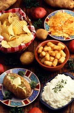 Various potato preparations: (clockwise from top left) potato chips, hashbrowns, tater tots, mashed potato, and a baked potato