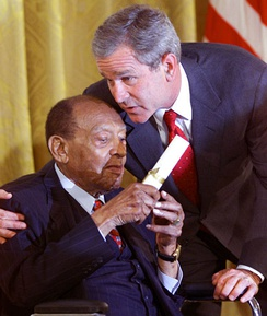 President George W. Bush honors Lionel Hampton during a ceremony recognizing Black Music Month in the White House in 2001.