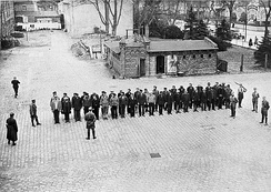 Prisoners guarded by SA men line up in the yard of Oranienburg concentration camp, 6 April 1933