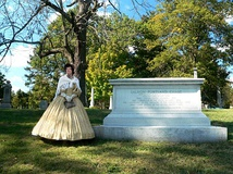 Grave of Salmon Chase in Spring Grove Cemetery; a docent is dressed in period clothing.