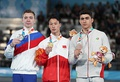 Pommel horse victory ceremony (from left to right): Sergei Naidin (Silver), Yin Dehang (Gold), Reza Bohloulzadeh (Bronze)
