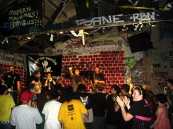 A band plays on the tiny stage at the Berkeley, California punk venue at 924 Gilman Street