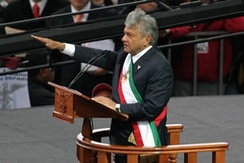 "López Obrador being proclaimed ""Legitimate President of Mexico"" by his supporters in November 2006[91]"