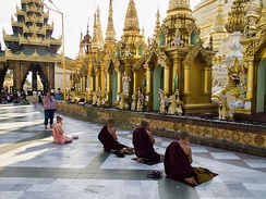 Praying Buddhist monks in Shwedagon Pagoda