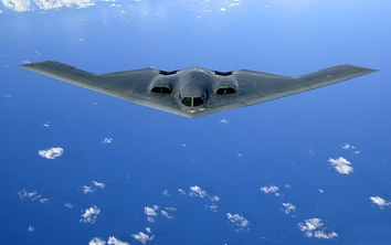 A U.S. Air Force B-2 Spirit in flight over the Pacific Ocean
