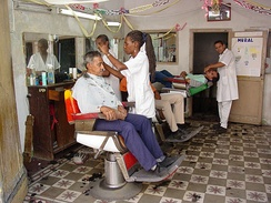 Independent, family-owned barbershops are a hallmark of Santiago
