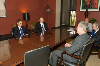 Baucus, foreground, meets with Secretary of Treasury nominee Timothy Geithner, left