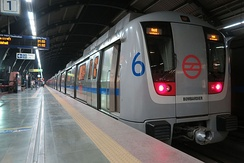 Coaches of Delhi Metro are color-coded to indicate each line or service, with named icons to indicate stations.