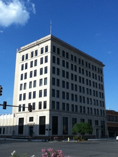 The First National Bank of Enid was another venture by oilman H.H. Champlin. During the Great Depression, it earned the distinction of being the only bank ever to be forcibly closed by the military.