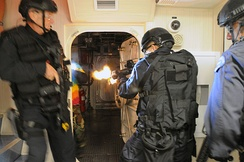 LAPD SWAT officers breaching a room