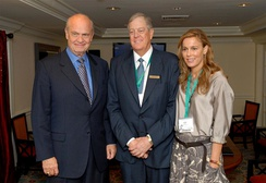Fred Thompson poses with David Koch and his wife Julia.