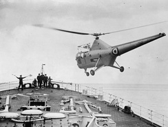 A Westland WS-51 Dragonfly coming in to land on the ship's foc'sle