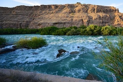 The Helmand River, known in ancient Iranian Avestan as Haraxvatī and Harahvaiti, is identified by some as the ancient Sarasvati river.