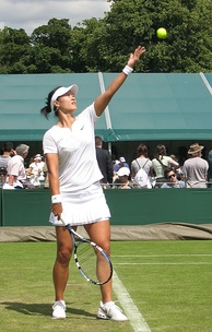 Li Na, a professional tennis player, serving at Wimbledon 2008, 1st round against Anastasia Rodionova