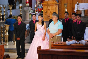A Mexican quinceañera after mass in church.