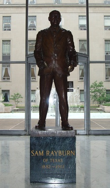 A statue of Rayburn near the ground level courtyard