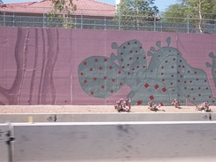 Stylized cacti decorate a sound/retaining wall in Scottsdale, Arizona