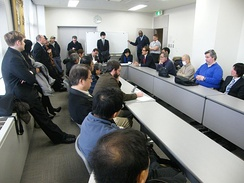 Union members and supporters hear the details of the Tokyo District Court ruling on February 27, 2012