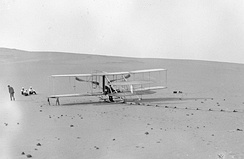 The modified 1905 Flyer at the Kill Devil Hills in 1908, ready for practice flights. Note there is no catapult derrick; all takeoffs were used with the monorail alone.
